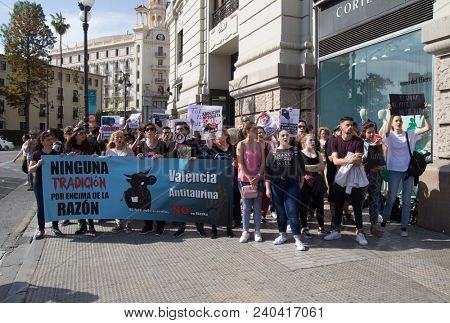 VALENCIA, SPAIN - MAY 12, 2018: Unidentified protesters in an anti bullfighting demonstrating in the streets of Valencia. Bullfighting currently takes place in nine countries around the world.