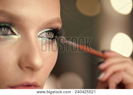 Woman Applying Black Mascara On Eyelashes With Makeup Brush. Young Beautiful Woman Applying Mascara
