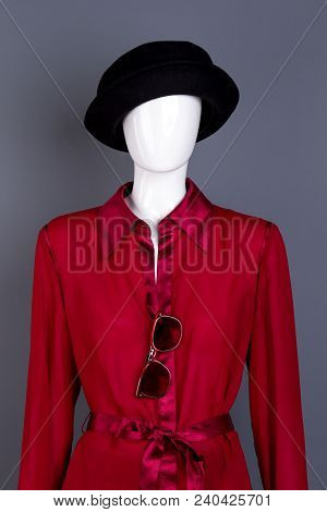 Mannequin Wearing Black Hat And Red Blouse. Stylish Feminine Garment On Dummy, Grey Background. Wome
