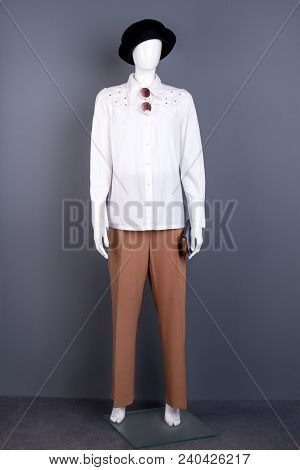 Female Mannequin In Black Hat And White Shirt. Women Fashion Apparel And Accessories On Mannequin. L