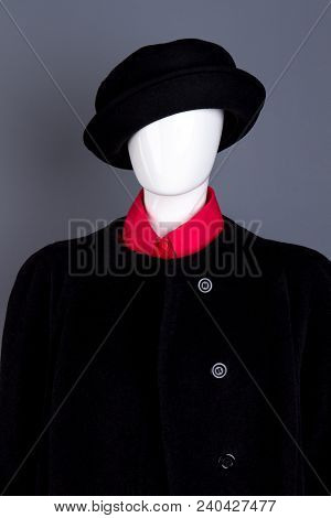 Black Hat And Coat On Female Mannequin. Red Women Shirt And Black Top Coat Dressed On Mannequin, Gre