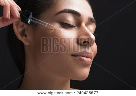 Youthfulness Concept. Close Up Of Pleased Female Expression With Closed Eyes. Woman Applying Serum O