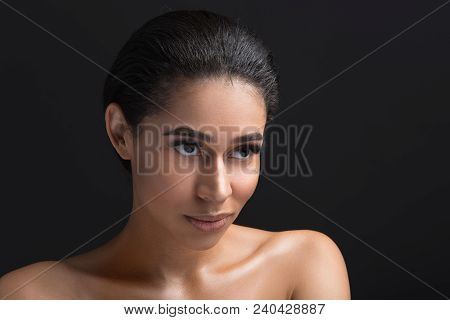 Portrait Of Good Looking Woman Having Tempting Glance. Her Eyelashes Are Long. Isolated On Black Bac