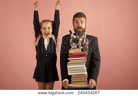Kid And Tutor Hold Huge Pile Of Books. Education And Back To School Concept. Teacher And Schoolgirl