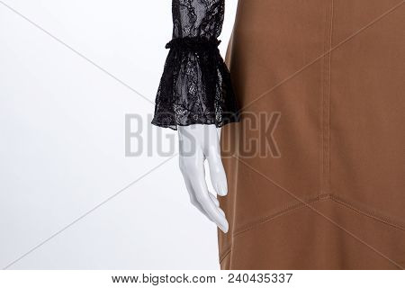 Close Up Mannequin Hand And Skirt. Female Mannequin In Black Long Sleeve Blouse And Skirt, Cropped I