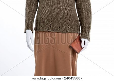 Close Up Skirt, Sweater And Wallet. Female Mannequin With Knitted Pullover, Brown Skirt And Purse Cl