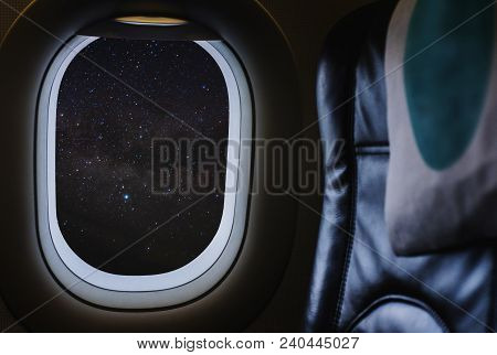 Travelling By Air Plane, Looking Through Plane Window Enjoying Beautiful Night Sky Full Of Stars And