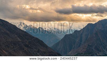 Panoramic Mountains Range Landscape White Overcast Sky In Sunrise, Pakistan