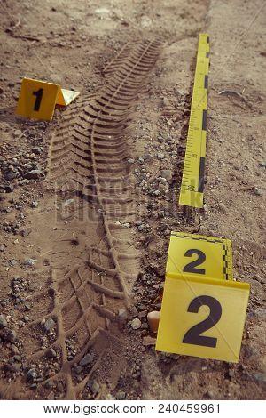 Crime Scene Investigation - Documenting Of Car Tire Print Left On Crime Scene