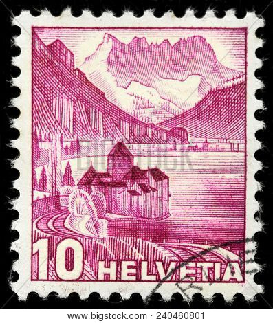 Luga, Russia - February 8, 2018: A Stamp Printed By Switzerland Shows Chillon Castle - An Island Cas