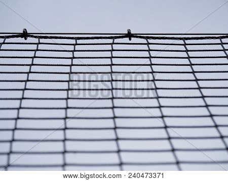 Football Gate Net With Bound Strings And Knots. Goal A Soccer Net With Green Grass Field
