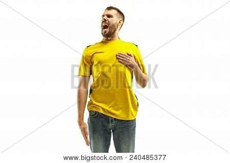 Brazilian Fan Celebrating On White Background. The Young Man In Soccer Football Uniform Standing And