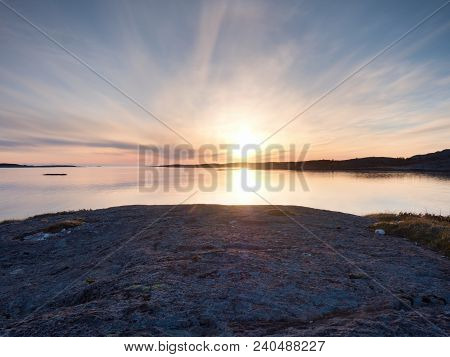 Smooth Evening  Sea Between Granite Rocks. Peaceful Background With Tranquil Calm Water. Purple Tone
