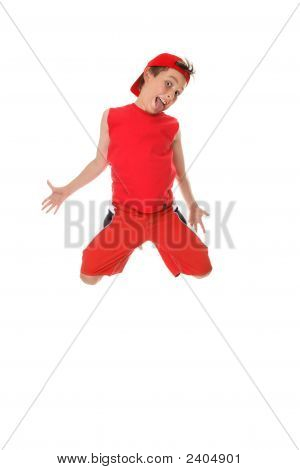 Larrikin boy jumping and poking out tongue. poster