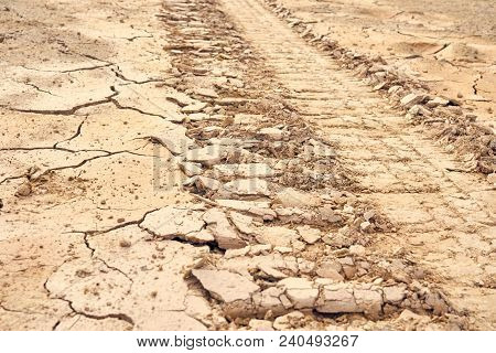 Wheel Alignment On Details Of The Ground The Cracks In The Soil. Due To The Lack Of Moisture In The