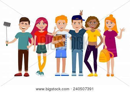 Group Of Cute Happy Teenagers Having Fun, Standing Together With Gadgets, Backpacks And Books. Schoo