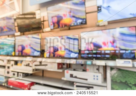 Abstract Blurred Electronic Department Store With Row Of Tvs In Usa
