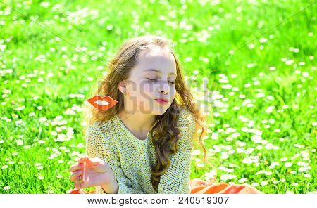 Kiss Concept. Girl On Kissing Face Spend Leisure Outdoors. Child Posing With Cardboard Smiling Mouth
