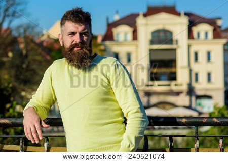 Man With Long Beard Enjoy View From Balcony. Relaxation Concept. Bearded Man Have Rest On Sunny Day