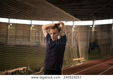 The Shot Of Male Track And Field Athlete Warming Up Before The Training.indoor Training