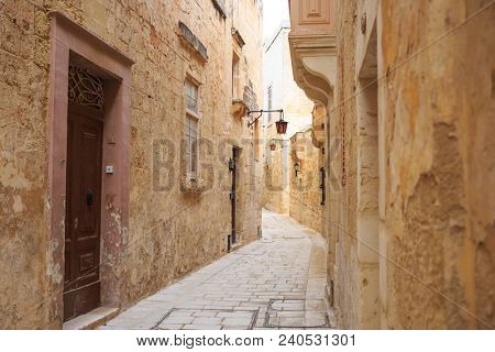 Mdina the old town with cobblestone narrow streets, lanterns, peeled buildings, in Malta. Perfect destination for vacation and tourism.