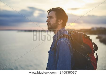 Sensual Guy Is Admiring Beauty Of The Nature. He Is Looking At Sea While Sunset Is On Background