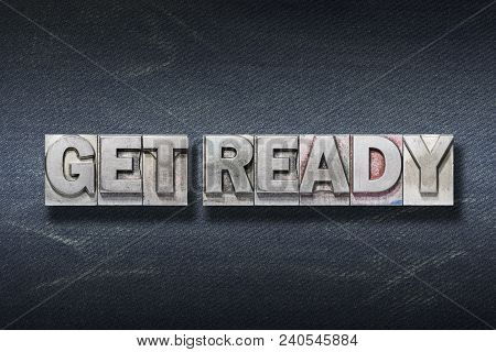 Get Ready Phrase Made From Metallic Letterpress On Dark Jeans Background