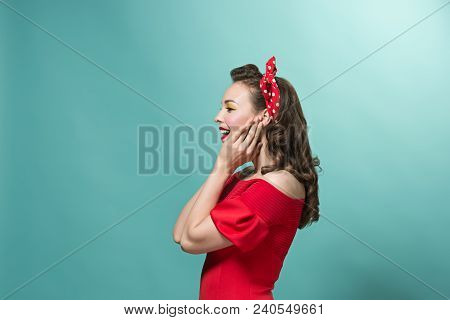 The Profile Of Young Woman With Pin-up Make-up And Hairstyle At Studio. Happy, Smiling And Pretty Fe