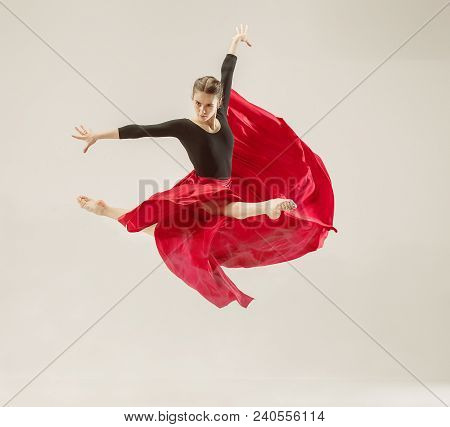 Modern Ballet Dancer Exercising In Full Body On White Studio Background. Ballerina Or Female Dancer