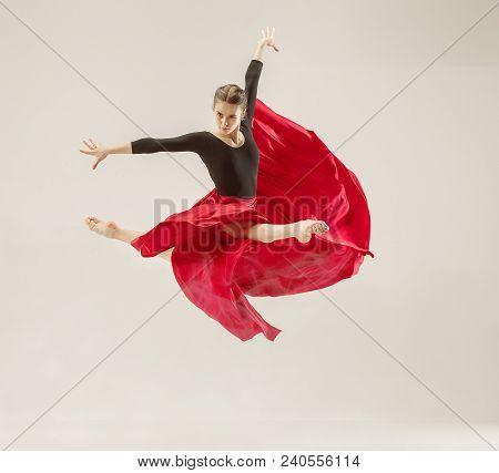 Modern Ballet Dancer Exercising In Full Body On White Studio Background. Ballerina Or Female Dancer