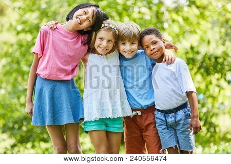 Multicultural children stand side by side as friends and strong team