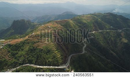 Aerial View Of Rice Terraces And Agricultural Farm Land On The Slopes Of Mountains Valley. Cultivati