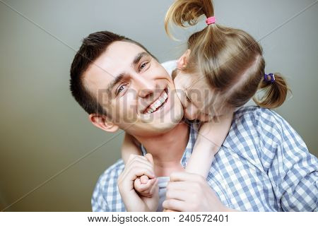 Happy Father's Day! Dad And His Daughter Child Girl Are Playing, Smiling And Hugging. Family Holiday