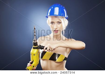 Model With Power Drill And Helmet
