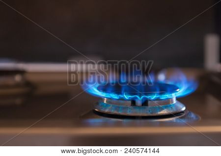 Beautiful Blue Flame On The Gas-fired Burner. Stock Photo