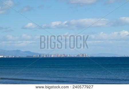 A Water Sea In A Coastline Non-urban Scene.