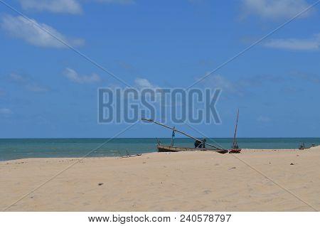 Traditional Jangada Boat Parked At White Sandy Beach, Cumbuco, Brazil
