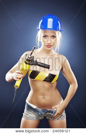 Blonde Model With A Power Drill In Jeans Shorts.