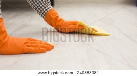 Unrecognizable Man Washing Wooden Floor With Towel In Living-room. Housekeeping, Home Cleaning And C