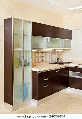 Part Of Modern Kitchen Interior With Cupboard In Warm Tones
