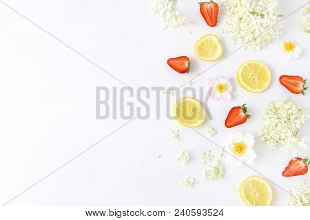 Styled Stock Photo. Spring Or Summer Fruit Composition. Sliced Lemons, Elderflowers, Strawberries An