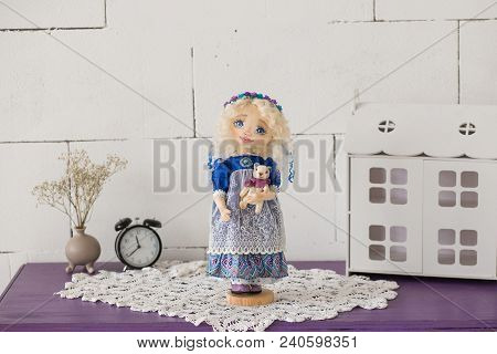 Portrait Of Textile Handmade Vintage Doll With Blue Eyes, Long Blond Hair In Old Blue Textile Dress