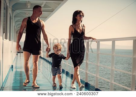 Family Travelling On Cruise Ship On Sunny Day. Family With Cute Son On Summer Vacation. Family Rest