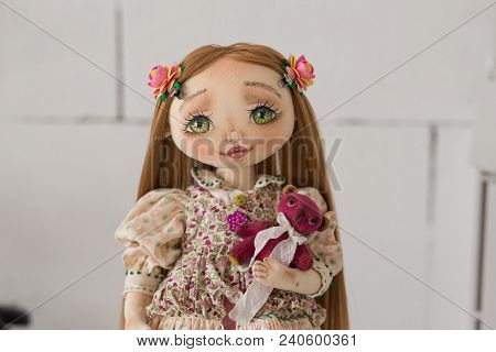 Portrait Of Textile Handmade Vintage Doll With Green Eyes, Long Brown Hair In Light Pink Textile Dre
