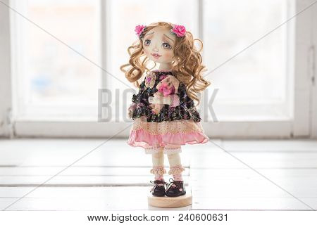 Portrait Of Textile Handmade Vintage Doll With Green Eyes, Long Brown Curly Hair In Light Pink And B