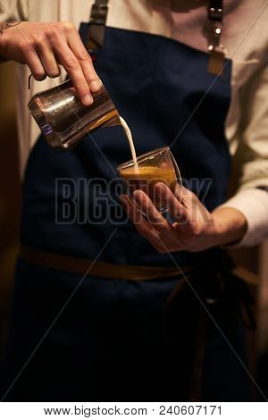 Barista Pouring Milk In Coffee Cup For Make Latte Art. Hand Of Barista Making Cappuccino Coffee Pour