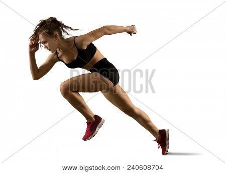 Woman sprinter leaving starting on the athletic track. Exploding start