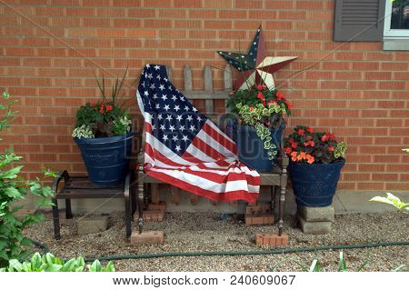 Bench Draped With A United States Of America Flag And A Decorative Star For Fourth Of July Independe