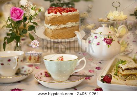 Morning tea, afternoon tea or high tea elegant set up of food ready to eat at bridal shower.  Ladies celebration with home made cakes and sandwiches.