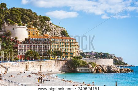 Nice, France - October 13, 2009: Beautiful Nicoise Architecture And People Relaxing On Beach That St